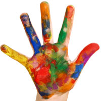 child's hand covered in all colors of paint