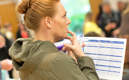 woman thinking holding plan documents
