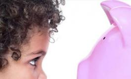Child looking at piggy bank