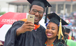graduates taking selfie