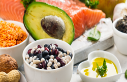 healthy fresh food: salmon, avocado, beans, olive oil