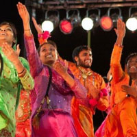 Cornell Bhangra dancers in colorful costumes