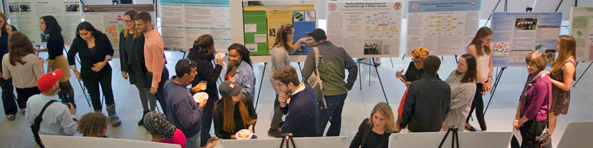 students and staff milling at an exhibition on campus