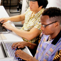 diverse students working on computers