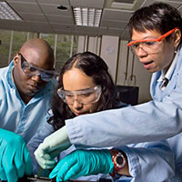 A diverse group of biomedical engineering students collaborate on a research project.