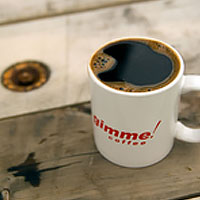 cup of black coffee on rustic wood table