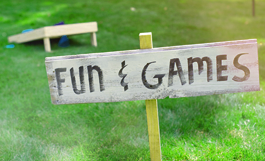 fun & games sign in grass