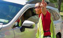 photo of man giving car driver directions