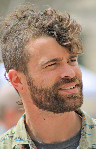 young man outdoors in sunshine