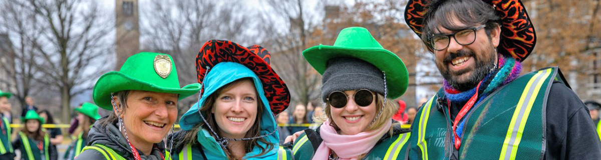 group of staff in fun hats volunteering at Dragon Day