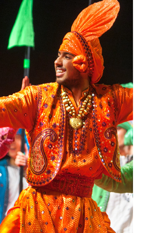 male member of Cornell bhangra dance troupe performing