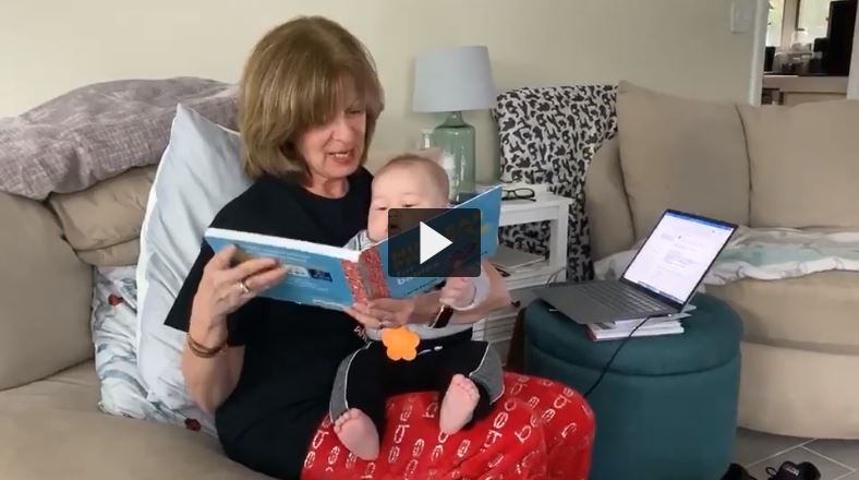 Mary Opperman reading to baby