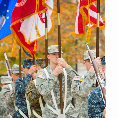 rotc members with flags on campus