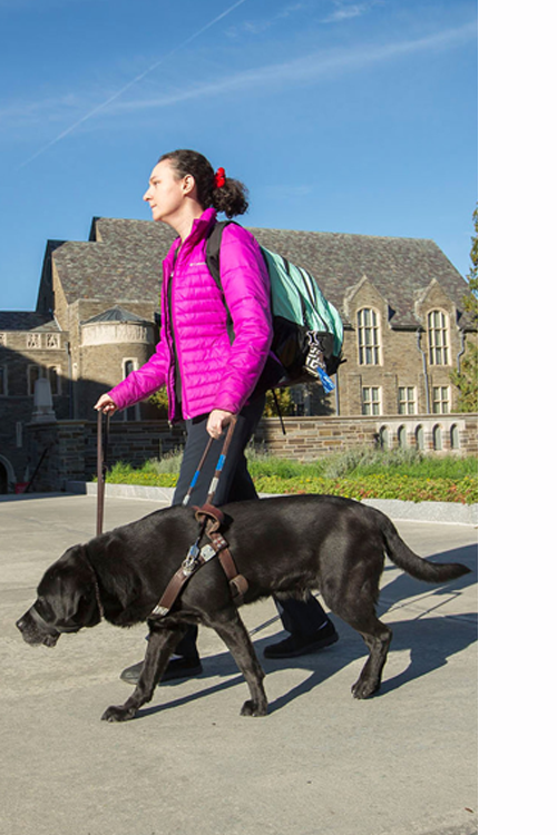 woman walking on campus with service dog