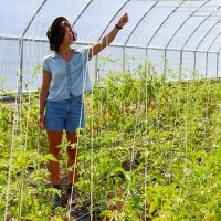 female student working in greenhouse