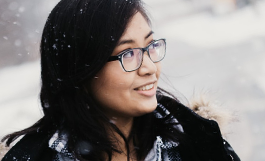 young woman smiling on snowy day